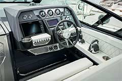 Helm of a Cruisers Yachts 338 Bow Rider