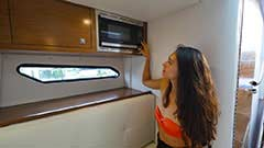 Microwave of a Cruisers Yachts 338 Palm Beach Edition - Bow Rider