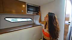 Microwave of a Cruisers Yachts 338 South Beach Edition - Bow Rider