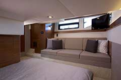 Aft Stateroom Starboard Sofa of a Cruiser Yachts 42 Cantius