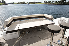 Aft Settee Table Down of a Cruiser Yachts 54 Fly
