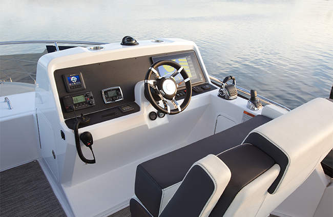 Helm of a Cruiser Yachts 54 Fly