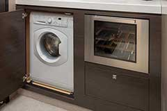 Washer, Dryer & Wine Refrigerator of a Cruiser Yachts 60 Fly